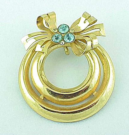 Vintage Costume Jewelry - Coro Gold Tone & Blue Rhinestone Bow On Circle Pendant