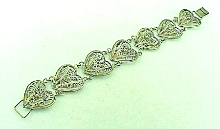 VINTAGE COSTUME JEWELRY - POSSIBLE STERLING SILVER FILIGREE HEART BRACELET (Image1)