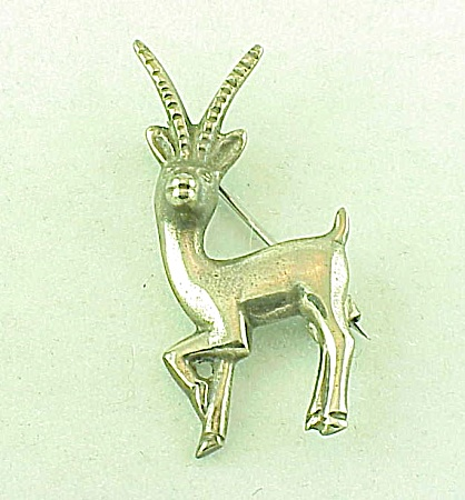 VINTAGE COSTUME JEWELRY - MEXICAN STERLING SILVER ANTELOPE C CLASP BROOCH (Image1)