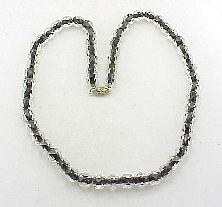 VINTAGE COSTUME JEWELRY - CLEAR GLASS CRYSTAL BEADS WITH BLACK CENTER NECKLACE WITH STERLING SILVER CLASP (Image1)