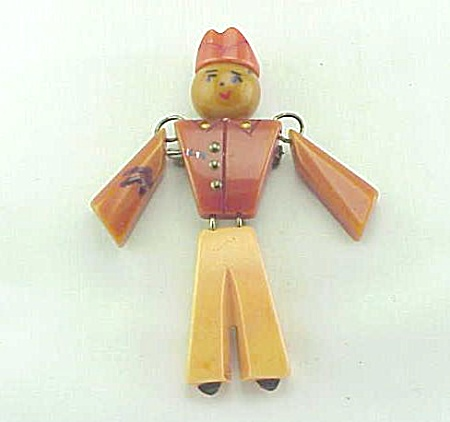 VINTAGE BAKELITE JOINTED MILITARY SOLDIER BROOCH OR PIN - BOOK PIECE (Image1)