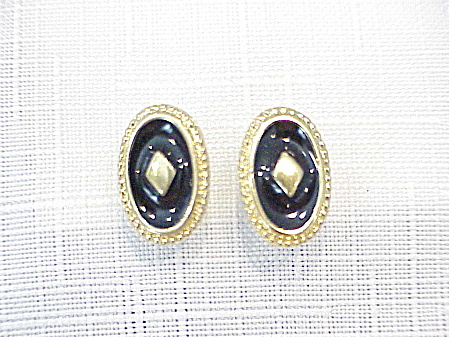 Black Enamel On Gold Tone Pierced Earrings Signed Trifari