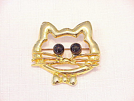 GOLD TONE CAT OR KITTEN FACE BROOCH WITH BLACK BALL EYES (Image1)