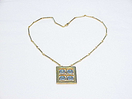MODERN GOLD AND SILVER TONE PENDANT NECKLACE SIGNED ARTISTRY (Image1)