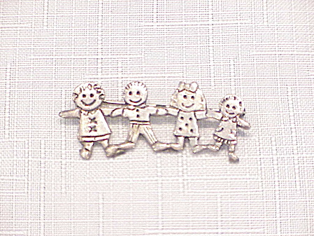 Sterling Silver Brooch Of 4 Children Or Dolls Holding Hands