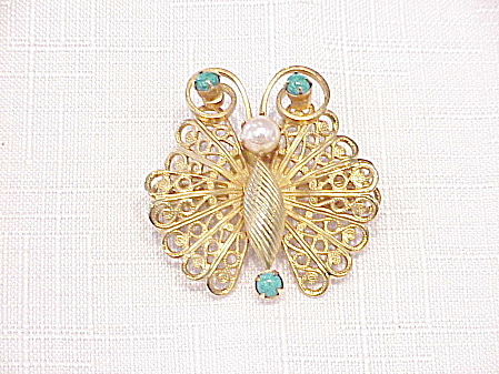 VINTAGE GOLD TONE FILIGREE BUTTERFLY BROOCH WITH BLUE BEADS AND PEARL (Image1)