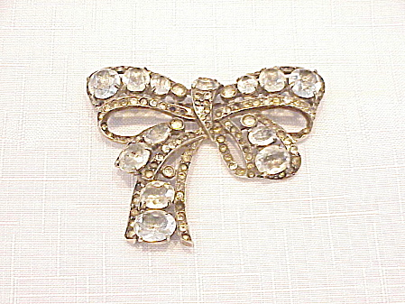 VINTAGE EISENBERG ORIGINAL STERLING SILVER AND RHINESTONE BOW BROOCH (Image1)