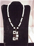 Click to view larger image of VINTAGE PARKLANE MOD STYLE LUCITE PENDANT ON BLACK, WHITE, SILVER BEAD NECKLACE  (Image1)