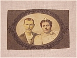 Click here to enlarge image and see more about item 3445: ANTIQUE HAND COLORED CABINET PHOTOGRAPH OF COUPLE WITH MAN IN DRAG OR UGLY WOMAN