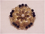 VINTAGE COSTUME JEWELRY - BROOCH WITH WIRED BLACK FACETED GLASS BEADS