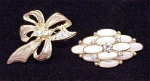 VINTAGE COSTUME JEWELRY  - 2 RHINESTONE BROOCHES - 1 WITH MOTHER OF PEARL CABACHONS
