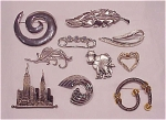 Click to view larger image of COSTUME JEWELRY - LOT OF 10 SILVER TONE BROOCHES - 1 SARAH COVENTRY, 1 JJ (Image1)