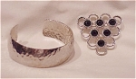VINTAGE COSTUME JEWELRY - HAMMERED SILVER TONE BRACELET AND BLACK RHINESTONE BROOCH SIGNED SARAH COVENTRY