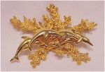 COSTUME JEWELRY - GOLD TONE SWIMMING DOLPHINS GROUP & CORAL BROOCH