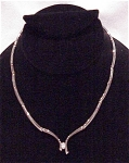 MODERNISTIC SILVER TONE CHOKER NECKLACE WITH SINGLE RHINESTONE