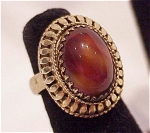 VINTAGE WHITING & DAVIS GOLD TONE RING WITH TIGER EYE GLASS STONE