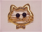 COSTUME JEWELRY - GOLD TONE CAT OR KITTEN FACE BROOCH WITH BLACK BALL EYES