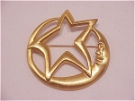 COSTUME JEWELRY - BRUSHED GOLD TONE MAN IN THE MOON AND STAR BROOCH