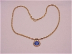 COSTUME JEWELRY - GOLD TONE SNAKE CHAIN NECKLACE WITH LARGE BLUE RHINESTONE SLIDE