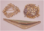 VINTAGE COSTUME JEWELRY - 3 TRIFARI BROOCHES - 1 ENAMEL, 1 GOLD TONE, 1 TWO TONE