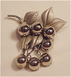 VINTAGE COSTUME JEWELRY - SILVER TONE BROOCH WITH LEAVES & DANGLING BERRIES