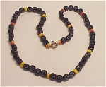 VINTAGE CARVED BLACK, RED AND YELLOW ART GLASS BEAD NECKLACE