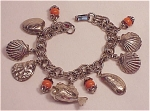 Click here to enlarge image and see more about item 06J2376: VINTAGE COSTUME JEWERLY - SILVER TONE BEACH THEME CHARM BRACELET WITH SEASHELLS AND FISH