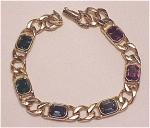 COSTUME JEWELRY - GOLD TONE LINK BRACELET WITH MULTICOLORED RHINESTONES