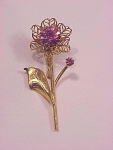 Click to view larger image of VINTAGE COSTUME JEWELRY - GOLD TONE PINK RHINESTONE FLOWER BROOCH (Image1)