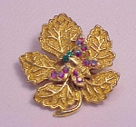 VINTAGE COSTUME JEWELRY - RHINESTONE BUTTERFLY ON GOLD TONE LEAF BROOCH