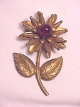 Click here to enlarge image and see more about item 06J2474: VINTAGE COSTUME JEWELRY - BRASS FLOWER C CLASP BROOCH WITH RED GLASS MARBLE BALL