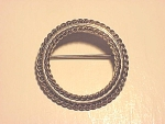 Click to view larger image of VINTAGE DANECRAFT STERLING SILVER SMALL CIRCLE BROOCH (Image1)