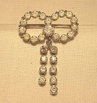 VINTAGE COSTUME JEWELRY - CLEAR RHINESTONE BOW BROOCH WITH DANGLES