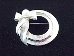 Click to view larger image of VINTAGE STERLING SILVER,  PEARL CIRCLE & BOW BROOCH SIGNED STAR-ART (Image1)