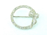 VINTAGE HOUSE OF SCHRAGER STERLING SILVER & RHINESTONE CIRCLE WITH BOW BROOCH