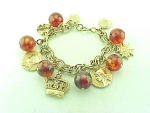 VINTAGE COSTUME JEWELRY - GOLD TONE CHARM BRACELET WITH ROYALTY THEME