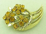 Click to view larger image of VINTAGE COSTUME JEWELRY - GOLD TONE AMBER RHINESTONE CORNUCOPIA BROOCH (Image1)