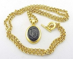 COSTUME JEWELRY - LONG BRUSHED GOLD TONE BLACK GLASS INTAGLIO CAMEO NECKLACE