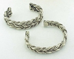 COSTUME JEWELRY - PAIR OF POSSIBLE STERLING SILVER BRAIDED CUFF BRACELETS
