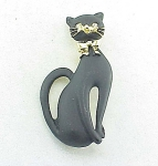 VINTAGE COSTUME JEWELRY - BLACK MATTE ENAMEL CAT BROOCH WITH RHINESTONE EYES