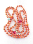 VINTAGE COSTUME JEWELRY - FLAPPER NECKLACE WITH GLASS BEADS & ORANGE LUCITE BEADS
