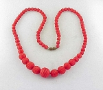 VINTAGE ART DECO CARVED OR MOLDED RED CELLULOID BEAD NECKLACE