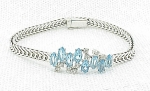 COSTUME JEWELRY - ITALIAN STERLING SILVER BRACELET WITH BLUE AND CLEAR RHINESTONES