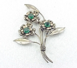 Click to view larger image of VINTAGE COSTUME JEWELRY - LARGE STERLING SILVER AND GREEN RHINESTONE FLOWER BROOCH (Image1)