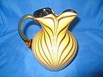 This Gold Limited Edition Dave Fetty Spout Pitcher was produced by Fenton in 2008 and is limited to 500 pieces, this one being #50!  Each has the Fenton logo, as well as Dave Fetty's mark and number. ...
