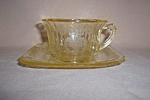 Click here to enlarge image and see more about item CA3219: YELLOW LORAIN BASKET CUP & SAUCER