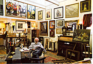 Man Reading in Art Gallery (Image1)