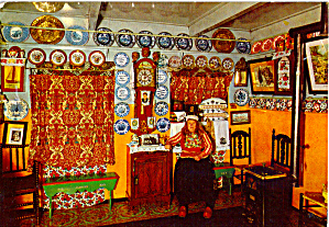 Woman in Native Dress Seated in Living Room (Image1)