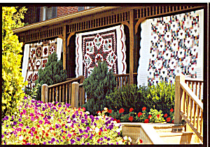 Amish Home with Quilts on Porch Postcard cs7045 (Image1)