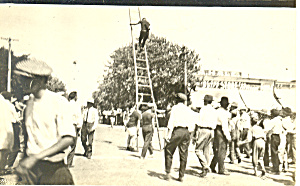 Man on Ladder RPPC Postcard (Image1)
